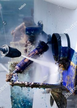 stock-photo-pressure-washer-cleaning-boat-hull-barnacles-antifouling-and-seaweed-82057435